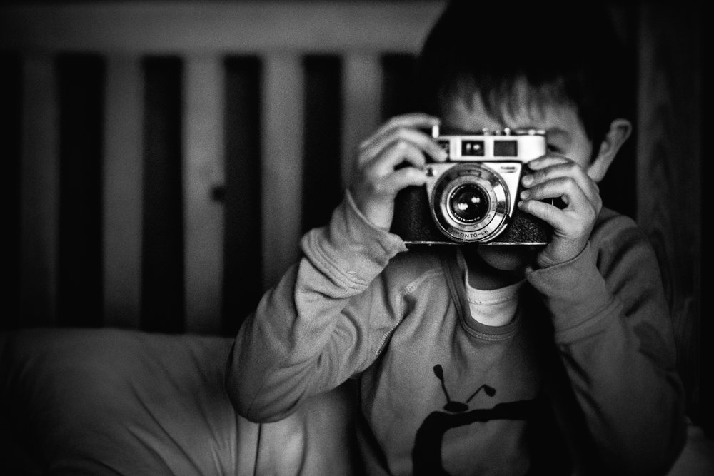 Boy with a vintage Kodak retinette camera