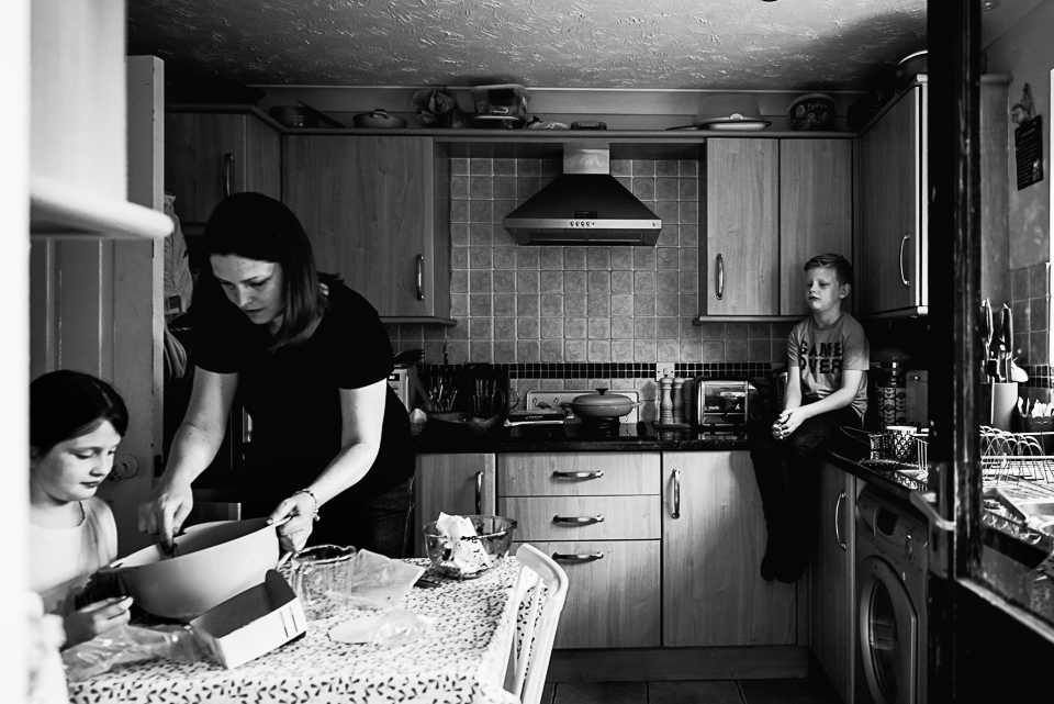 Black and white photograph of an everyday scene in the kitchen