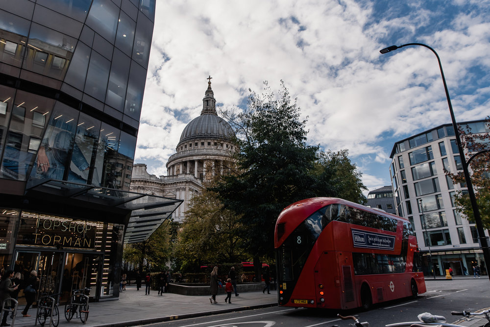 St Paul's cathedral at street level with a London red bus in the