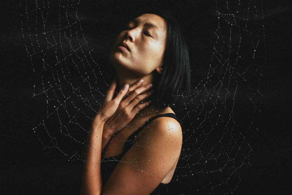 Double exposure self-portrait with a spider web