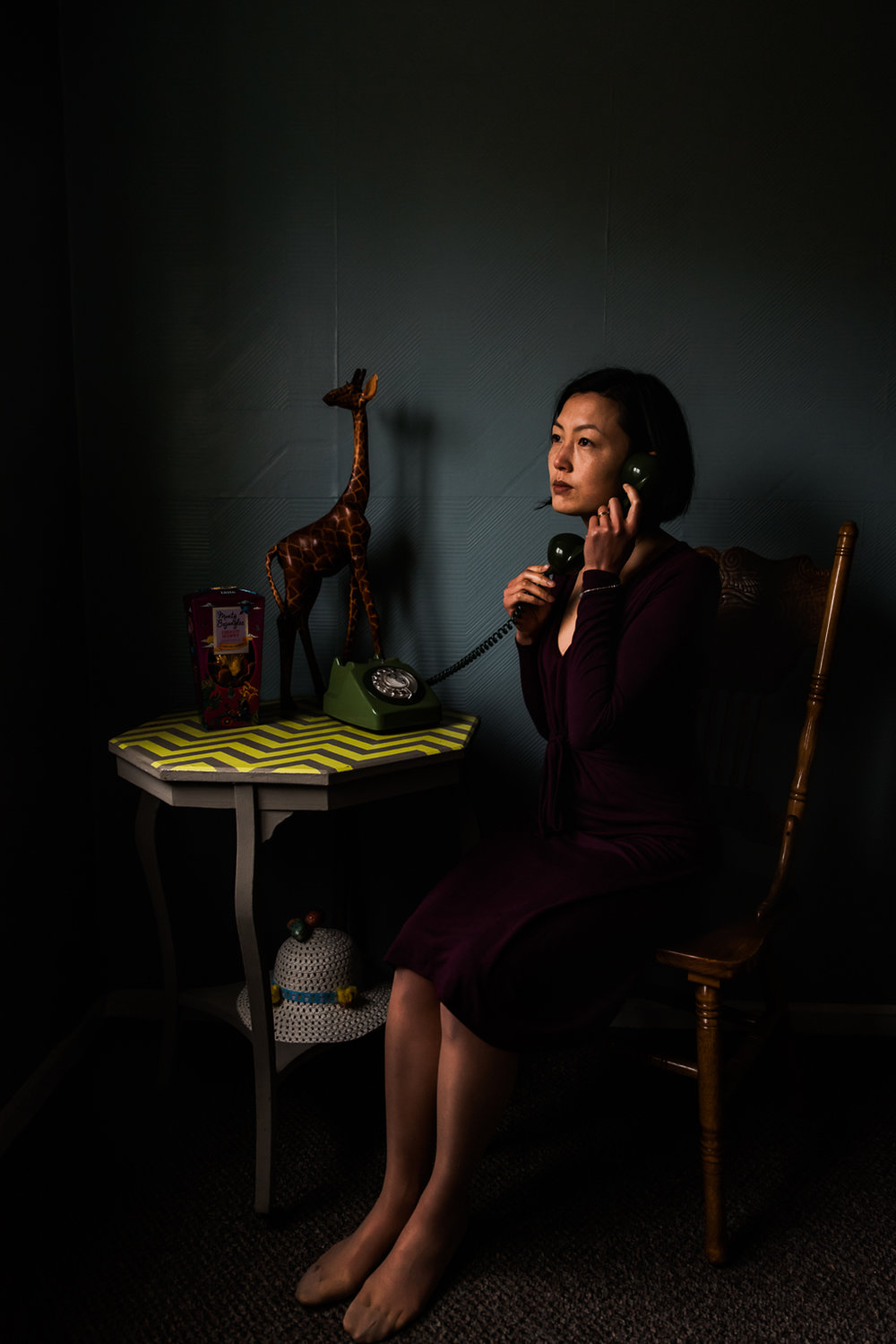 Photographer sits with her telephone in her hands surrounded by
