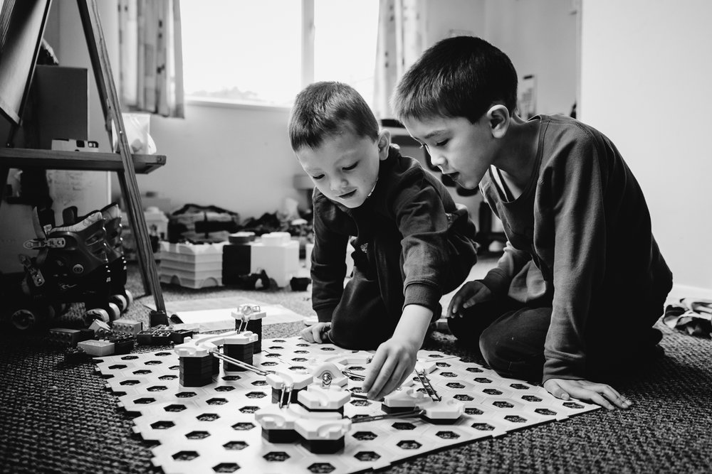 Brothers playing on the Gravitrax