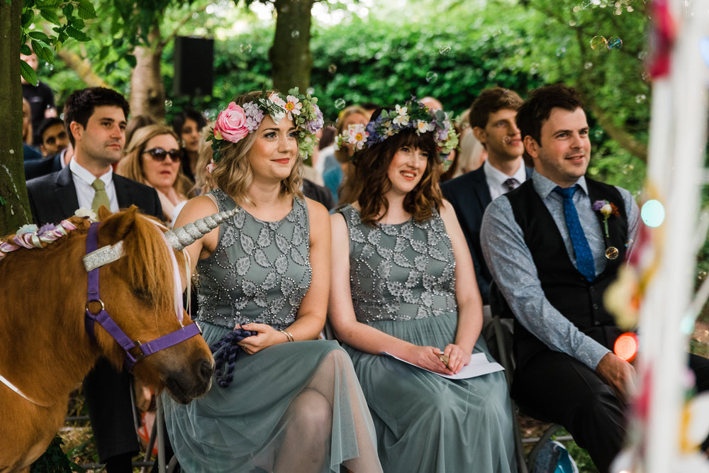 Wedding guests at an outdoor wedding ceremony in a Cambridgeshir