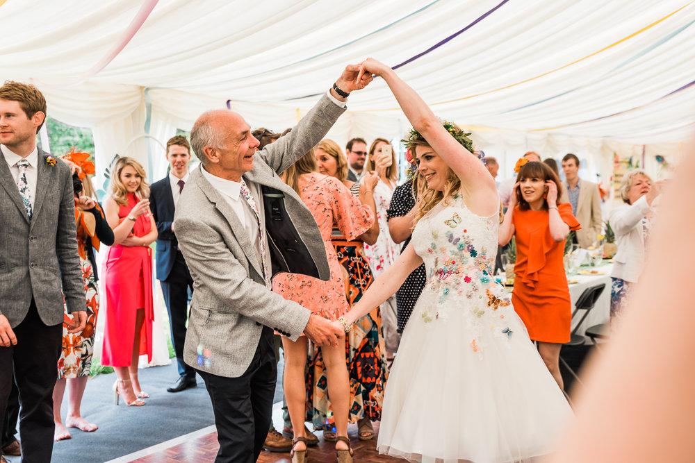 Bride dancing with her father at her outdoor wedding