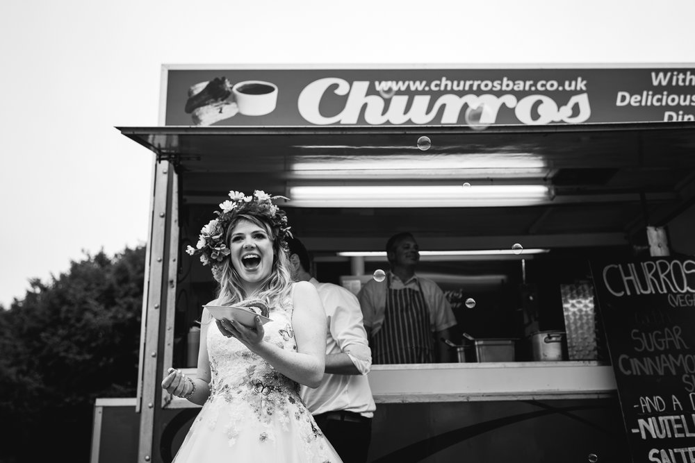 Bride with her churros from Churros Bar in Cambridge