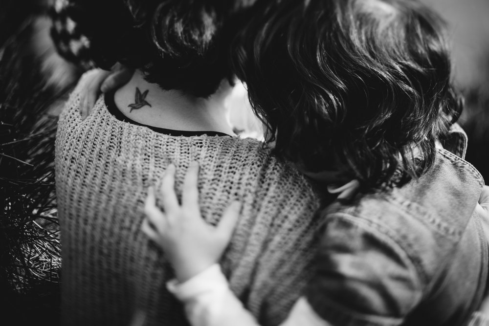 Copy of A child's hand on her mother's shoulder during a photo session b