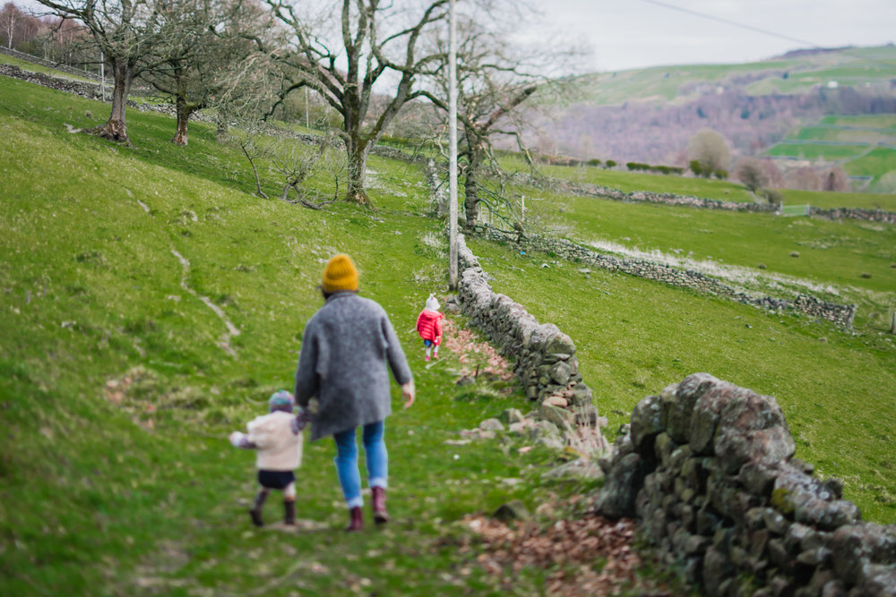 Copy of A mother and her two children walking in Cragg Vale