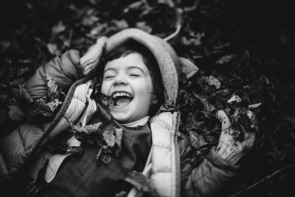 Copy of Black and white freelensed portrait of a little girl rolling aro