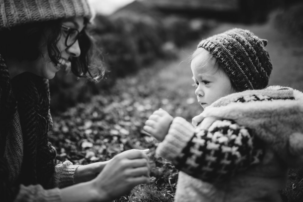 Copy of Freelensed photograph of a mother and her toddler child in black