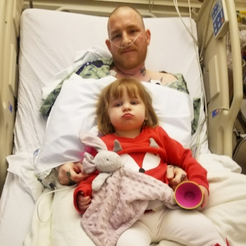 My husband and daughter, Emmy during one his several hospital stays.