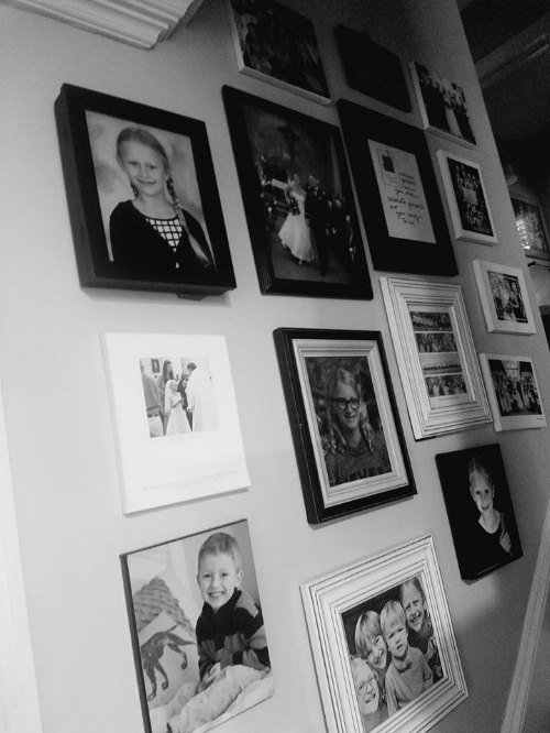 This is a stair gallery in our house. Hard to grab a photo of this, but the angle of the bottom pictures is going along the stair line. Everything is in a white or black frame to give balance. Objects that are not framed are balanced with those that are.