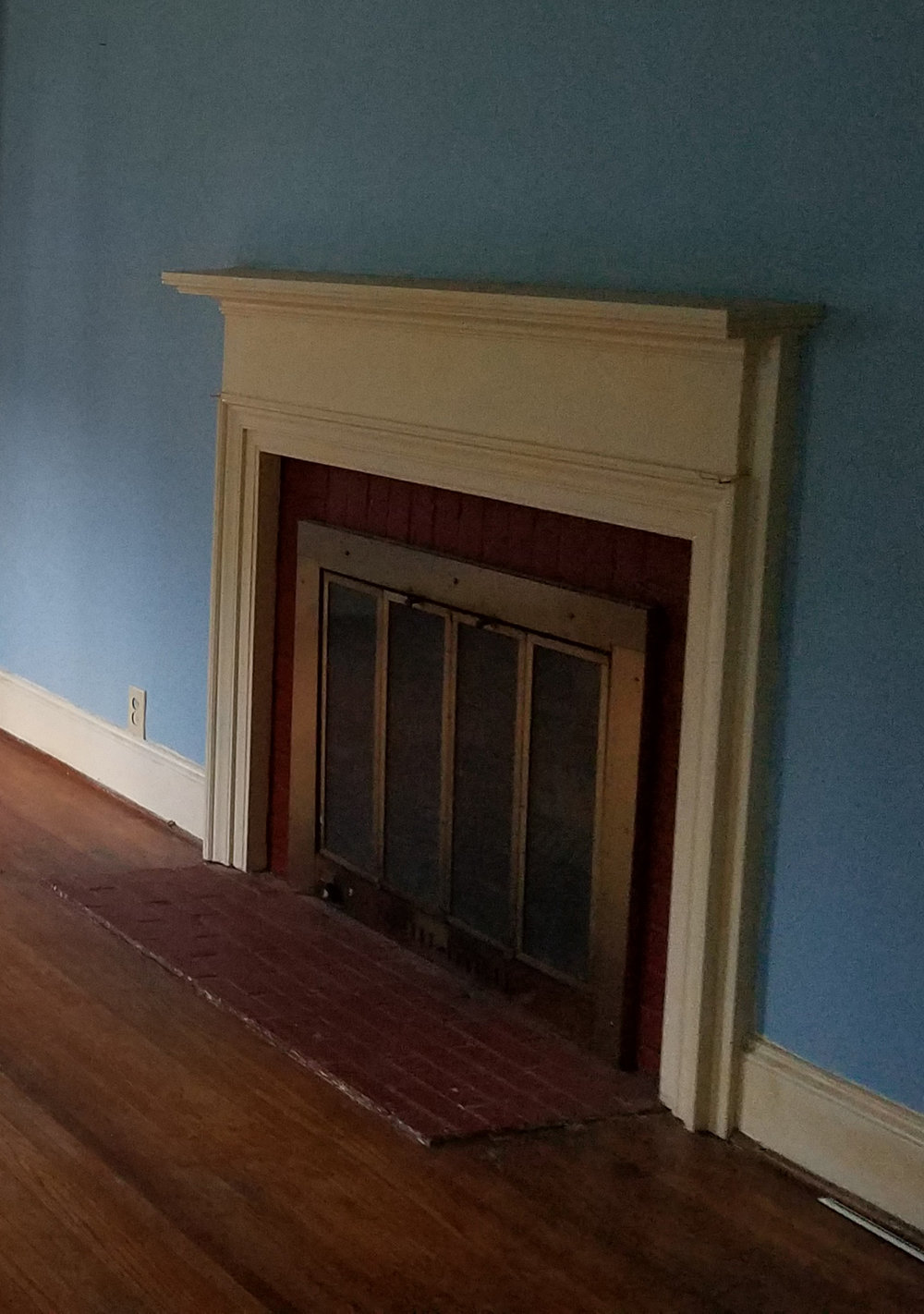 Haymount Homes Glenville Ave fireplace before.jpg