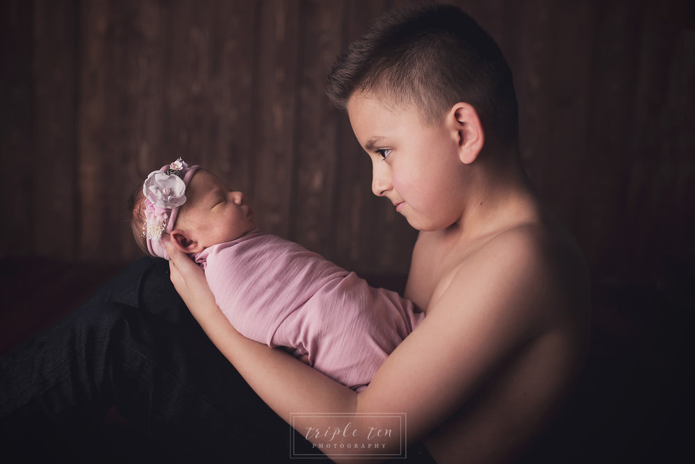 red deer newborn photographer sibling pictures.jpg