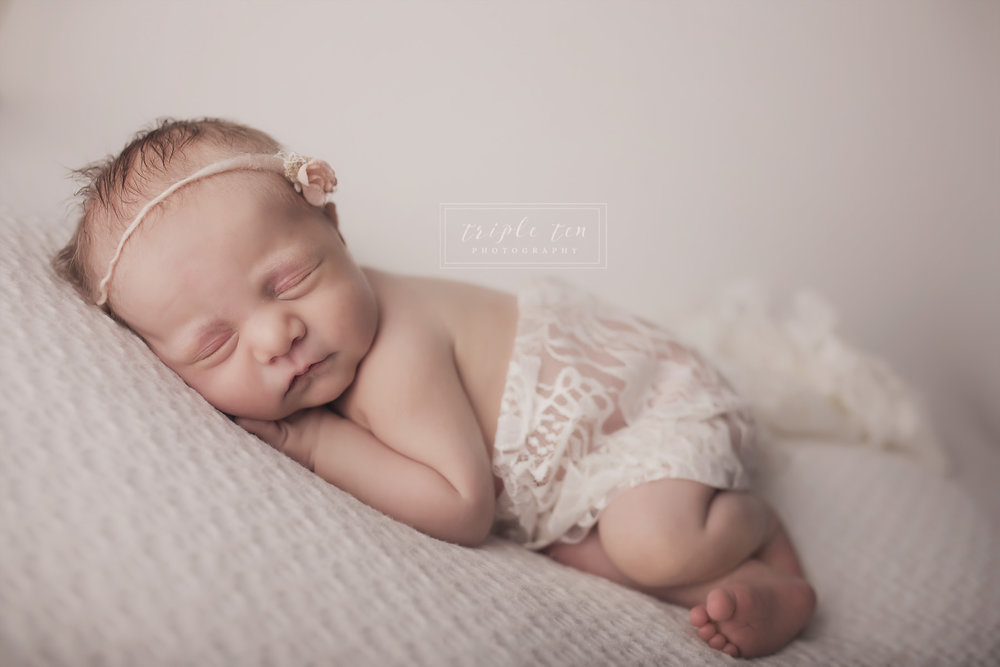newborn in lace red deer photographer.jpg