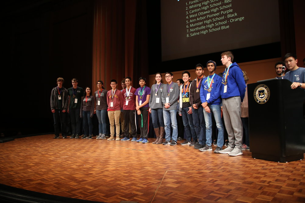 Winners of one of the 23 competition events, standing on the stage of the  Rackham Auditorium .