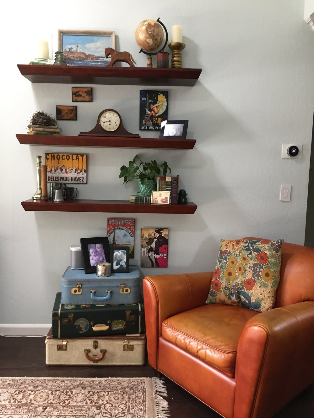 Home redesign using clients existing items creating an updated look for their space on a budget.