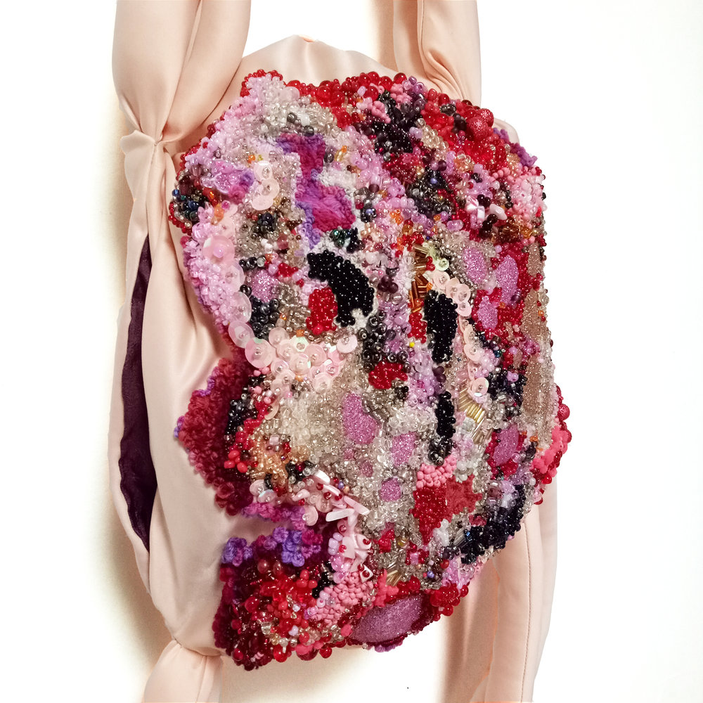 Flesh Sac (Back Pack)  2017   Embroidery of salvaged materials, (wool, polyester, glass, plastic, shell, wood, nylon, poly-fibre fill) Dimensions variable, approximately 95cm x 40cm x 22cm
