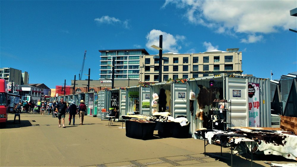 Markets along the Wellington waterfront having a browse is a great thing to do in Wellington on a budget