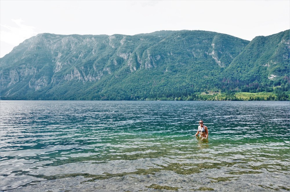 swimming in Lake Bohinj, Slovenia as a stop off on a road trip in the Balkans