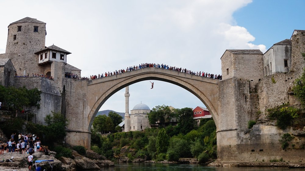 Person jumping from the bridge in Mostar, Bosnia and Herzegovina #balkans #mostar