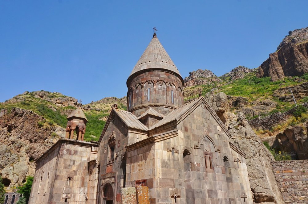 The Geghard Monastery with its beautiful surrounding should definitely be part of your trip in Armenia. Visit Geghard Monastery in Armenia.