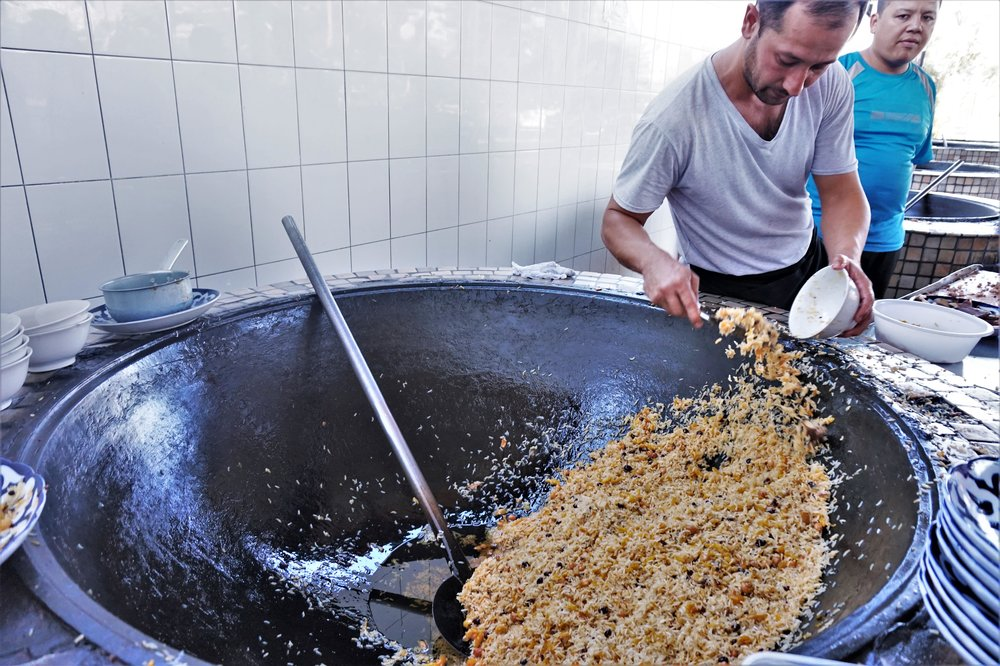 Plov is the national dish of Uzbekistan and one of the best things to try in Tashkent, Uzbekistan. To see how they cook massive amounts of plov at the plov center is one of the best things to do in Tashkent, Uzbekistan.