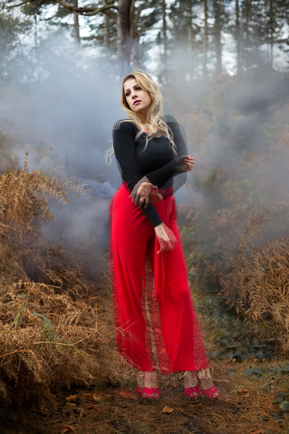LEA-COOPER-PHOTOGRAPHY-WILLENHALL-WEST-MIDLANDS-WOLVERHAMPTON-PORTRAIT-MEGAN-REECE-RED-TROUSERS-SLOW-MOTION-SMOKE-BOMB.jpg
