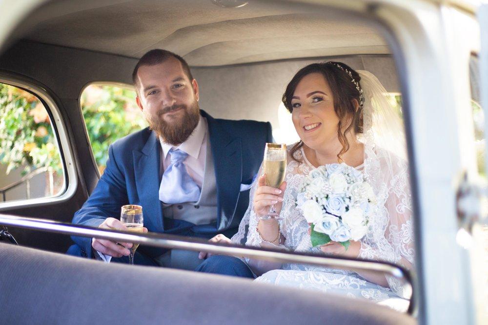 Lea-Cooper-Photography_Wedding-Photography_Willenhall_Wolverhampton_West-Midlands_Photographer_Birmingham_champagne-in-vintage-car.jpg
