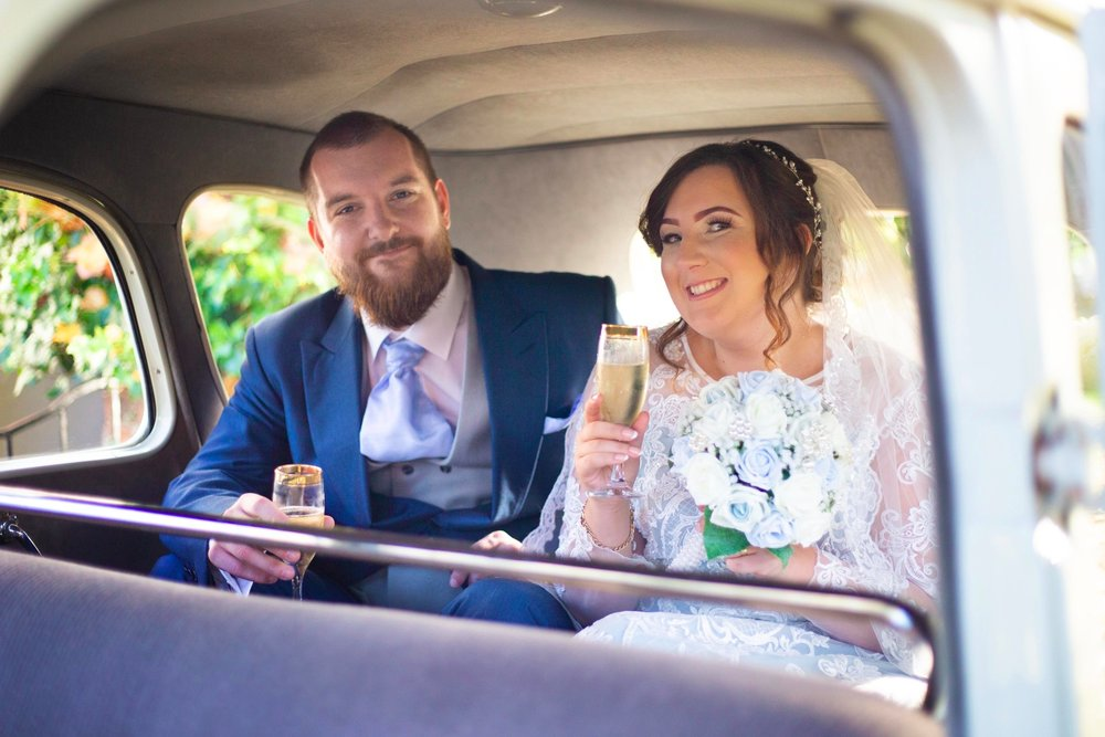 Lea-Cooper-Photography_Wedding-Photography_Willenhall_Wolverhampton_West-Midlands_Photographer_Birmingham_champagne-in-vintage-car.jpg
