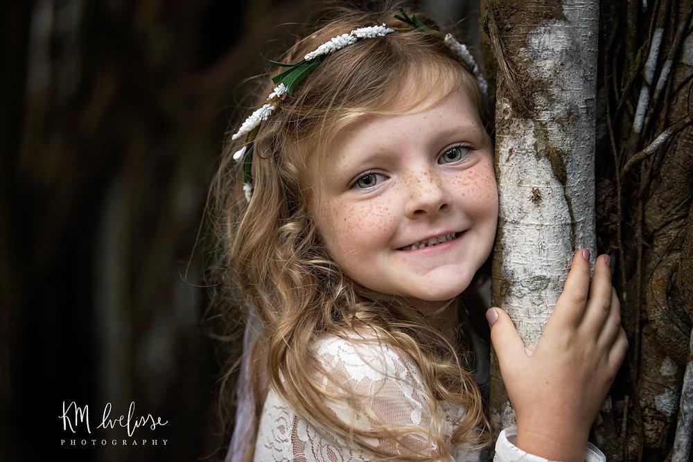 child portraiture kawela bay beach oahu hawaii smiling
