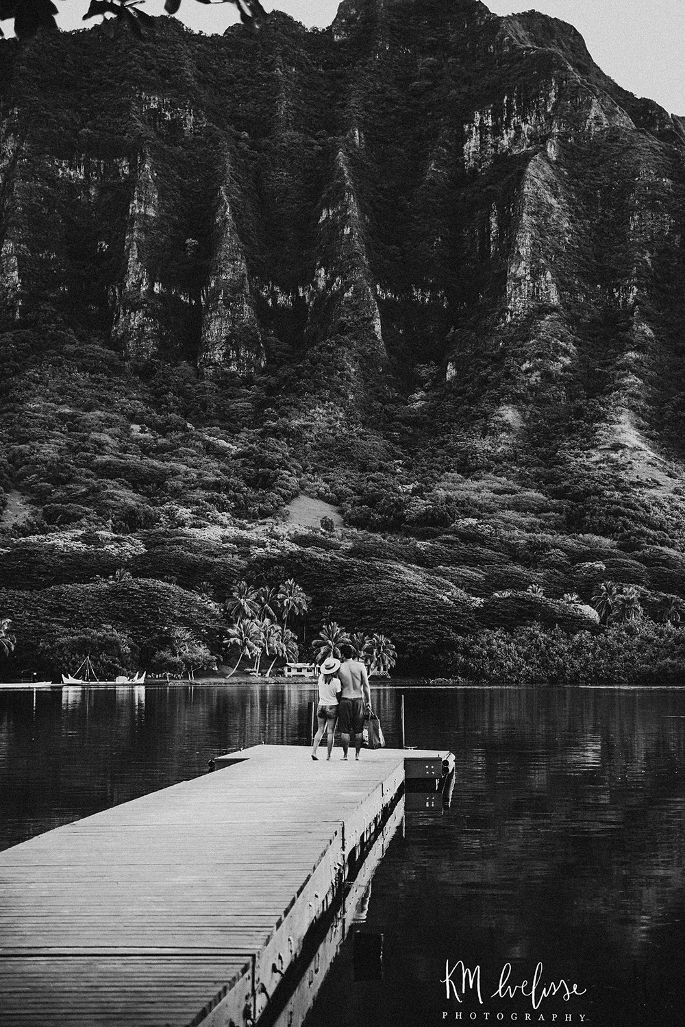 candid couple secret pier looking at mountains black and white love photography