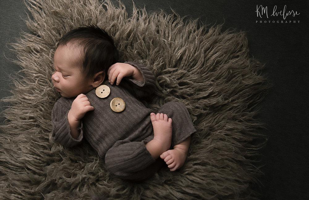 brown flokati boy newborn image in home studio outfit