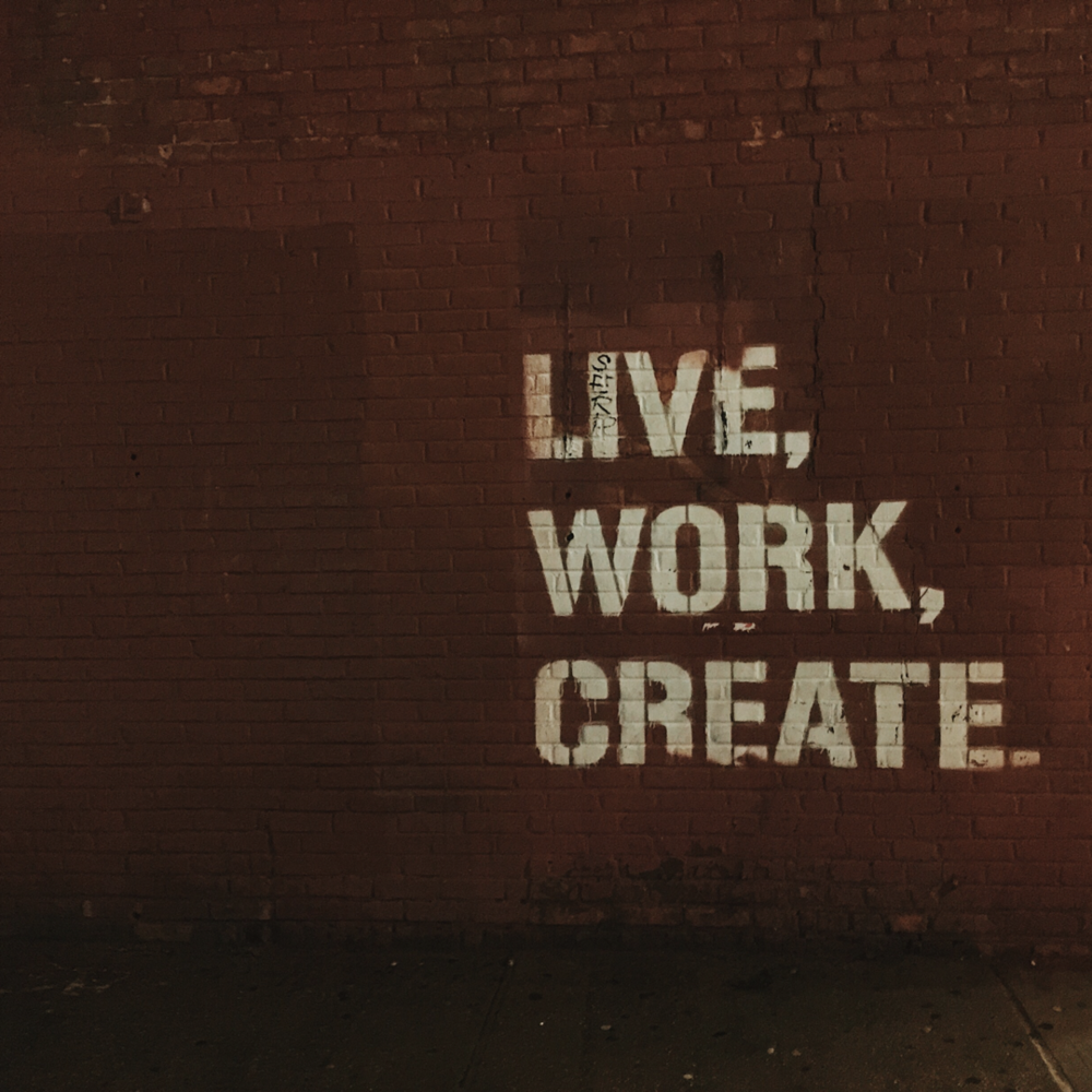 Wall with Live. Work. Create. written on it in graffiti