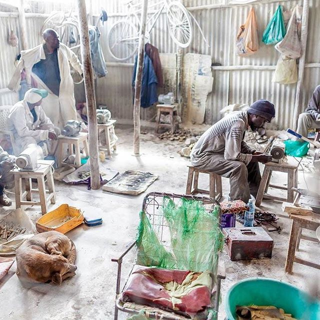 Men working inside Victorious Bones Craft - a workshop in Kibera where bones are recycled to make wonderful jewelries and other accessories. Photo by Bryan @kiberastories. #everydayafrica #reclaimphoto