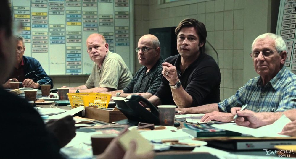 "The scouting scene from the movie ""Moneyball"""