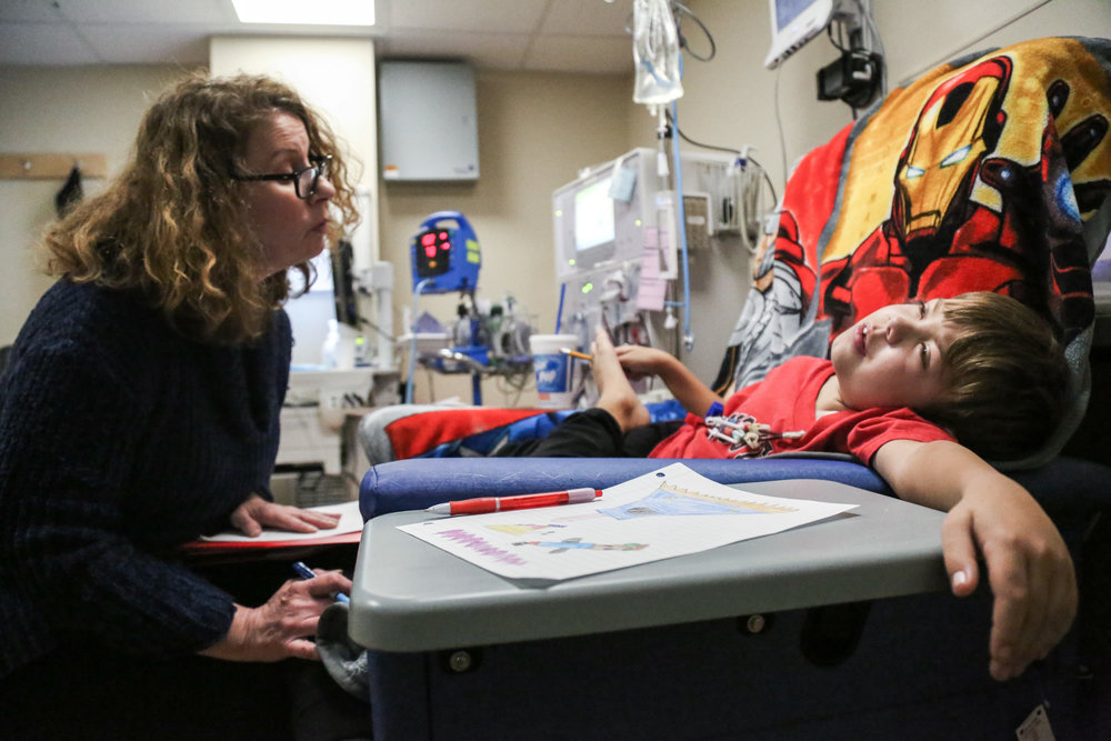 Harrison has hemodialysis treatment for 3-4 hours, three times a week. He has been taking treatment in the UNC hospital for over five years. Karen Weatherly, one of the hospital school teacher, stays with him every time he visits. She has almost become his family member.