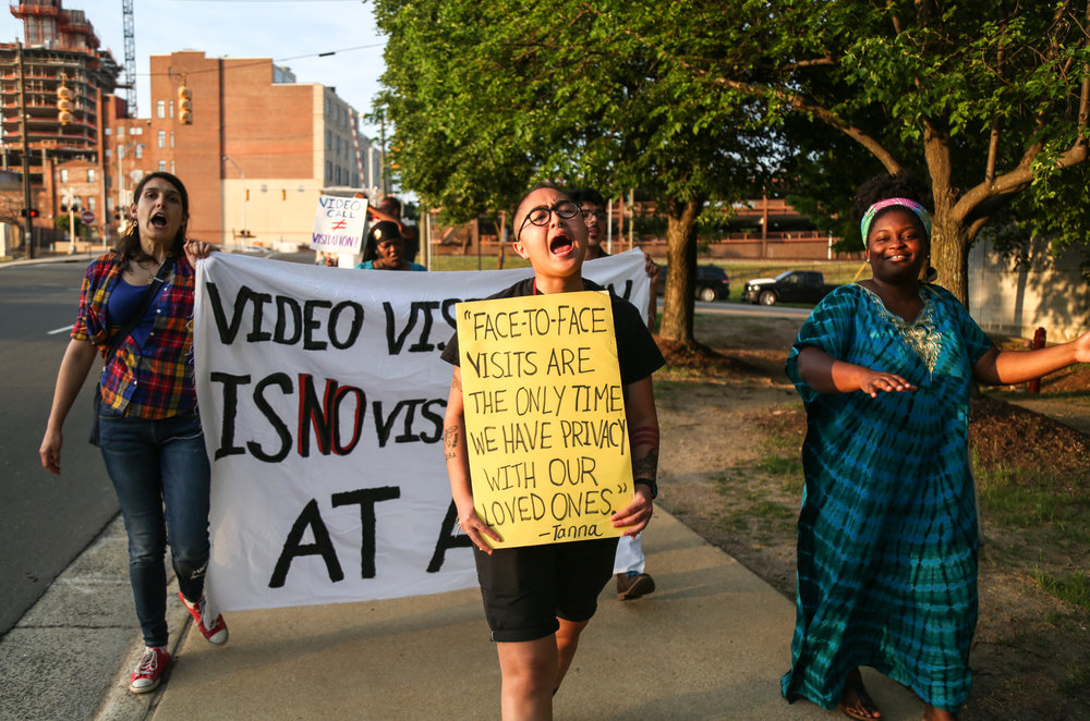 Loan protests against visitation by video instead of the actual visitation in front of the Durham Jail. The protests have lasted for several months and happen every Friday afternoon from 6 p.m. to 7 p.m.
