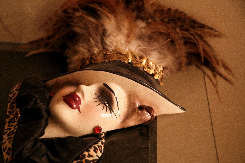 Justin Natvig, 35, is a drag queen who has been doing drag performances for over 19 years. He keeps this ceramic woman's face mask as a decoration on a table outside his bathroom.