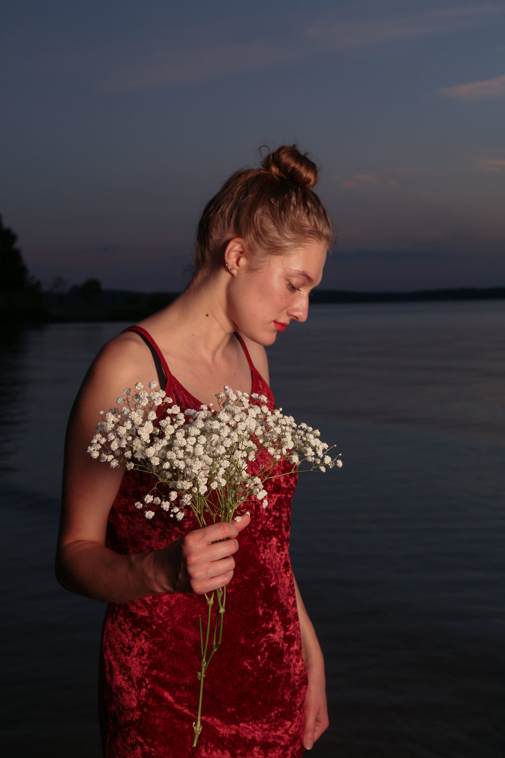 This portrait series was shot in the evening of Sep.16, 2016 at the Jordan Lake, NC, featuring a senior photojournalism student Clair Collins. The red velvet dress is picked on purpose to match the golden hour.