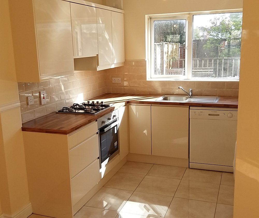 Kitchen with cream tiles.jpg