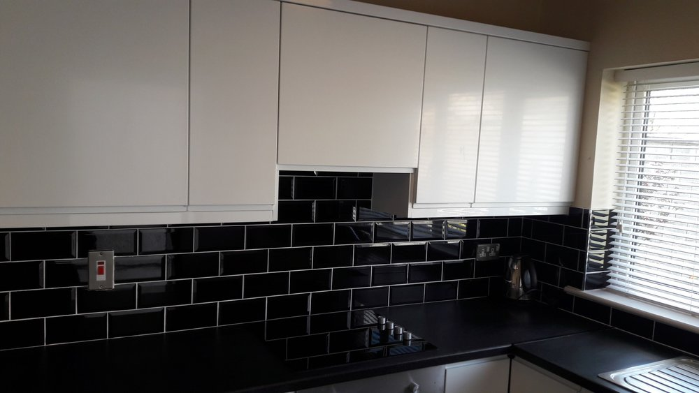 Kitchen with black tiles.jpg