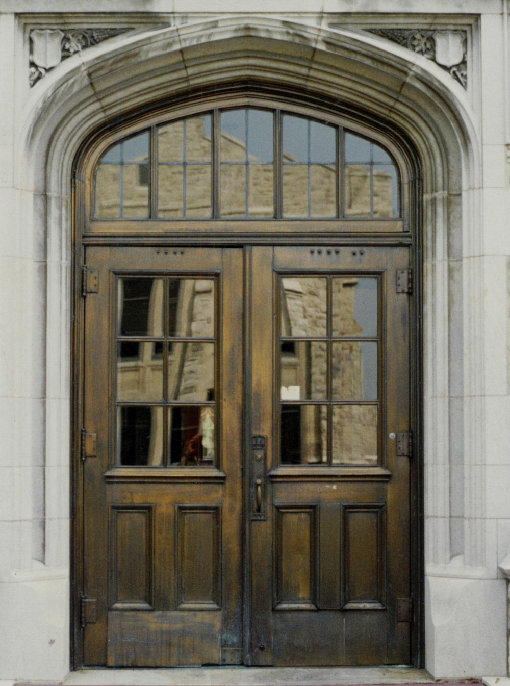 Previously Wood, Now Aged Bronze Doors