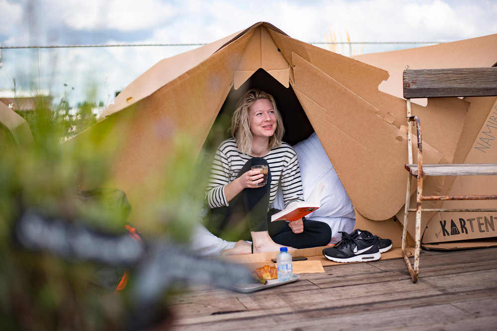 Innovative cardboard tents were provided. Tickets included dinner, live music, breakfast and yoga in the morning.