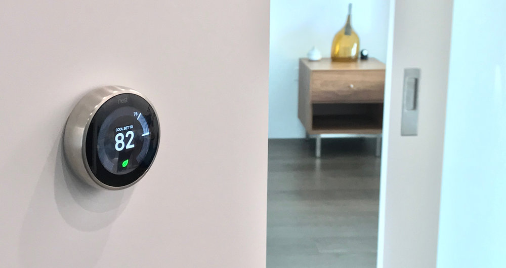 THIS PICTURE SHOWS AN ACTUAL NEST THERMOSTAT INSTALLATION BY LOCK-IQ.