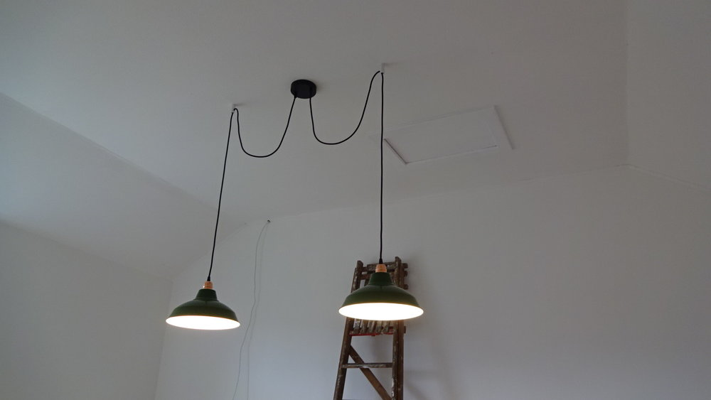 I made sure that the cable clamps on the rose were taking the weight of the flexes and pendants, otherwise, the actual wire connections take the strain and this can be dangerous.  The end result - both pendants hung and the two outlet rose fixed back to the surface bracket. Now just to get the new kitchen fitted and build the dining table!