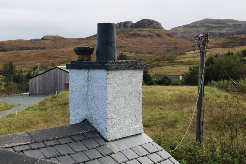 With work below taken as far as possible, it was time to venture up on the roof and think about feeding the flue through the chimney