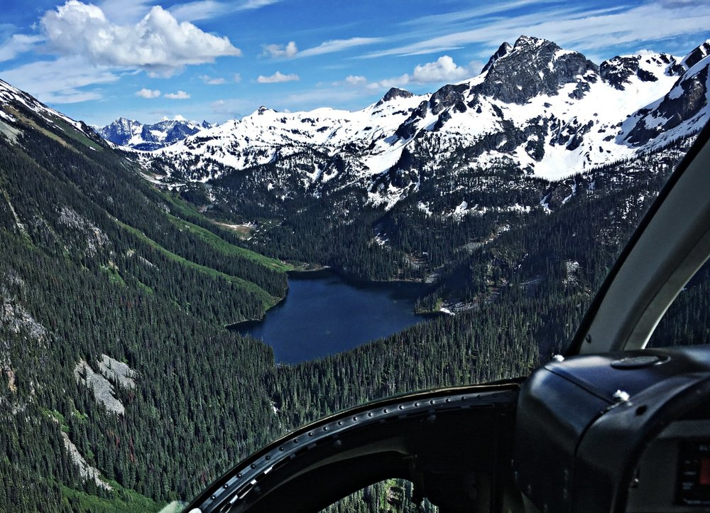 Alpine Lakes - 18 Minutes. Experience the thrill of helicopter flight as we explore the majestic Monashee mountains. Follow stunning creeks and waterfalls as we climb towards emerald blue/green lakes and captivating alpine scenery.$429 plus tax (per helicopter - up to 4 people)