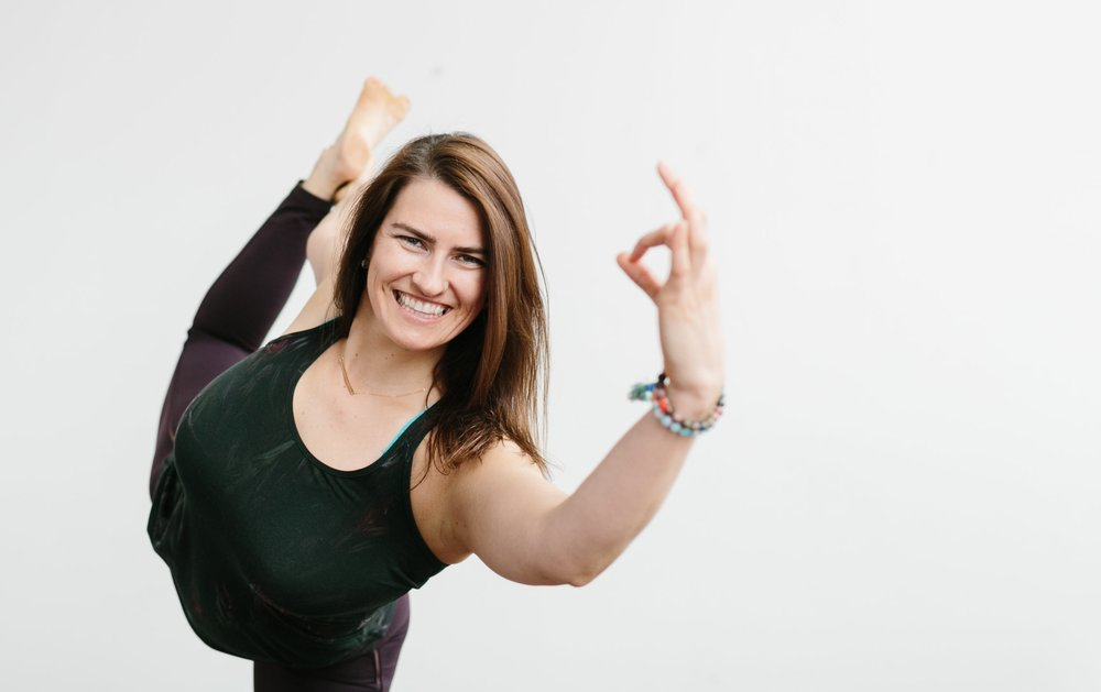 """KATE MANCHESTER    E-RYT 200, RYT 500,   Integrative Health Coach,Lead Faculty Teacher.   Kate lives by the mantra """"Don't just live…thrive."""" She is passionate about living a healthy life and balances her daily regime with exercise and self-discovery.After a fractured hip during triathalon training, Kate sought her yoga practice for physical and mental recovery. Teaching since 2012, Kate has been co-teaching red lila's 200 hour YTT program since the first training,and has successfully since led over five teacher trainings.She is a self-admitted Trader Joe's and Whole Foods addict, and is a student of the healing and energizing powers of food. Kate is also the Assistant Director of Development at the Cal Ripken, Sr. Foundation."""