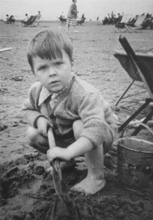 Young Charlie on the beach with his bucket and spade!