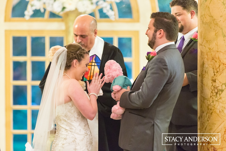 The officiant has known Melissa her whole life, so he included special gifts for the couple during his message.